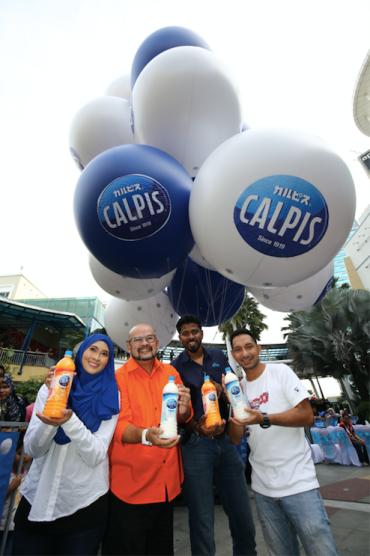 Image 02 - Group photo of the Calpis ambassadors and Santharuban T. Sundaram, Vice President of Marketing at Etika Sdn Bhd before the lift-off