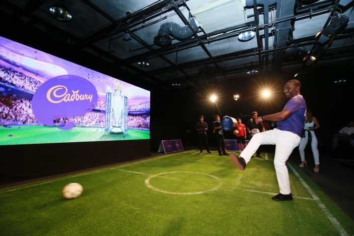 Andrew Cole kicks off the launch of Cadbury's partnership with the Premier League in Malaysia