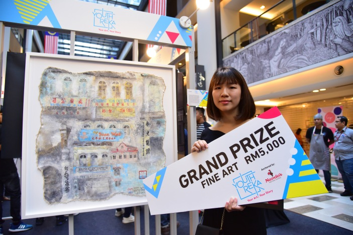 Fine art Grand Prize Winner, Choo Ai Xin with her art work, Old Town Ipoh